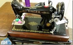 Singer 99 sitting in the vintage typing table