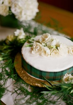Homemade white wedding cake with roses and plaid ribbon. Laura Murray Photography