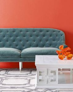 Orange wall and blue couch