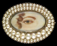 Rose gold oval brooch surrounded by double asymmetrical row of seed pearls. Collection of Dr. and Mrs. David Skier. #lookoflove #eyeminiatures #loverseye