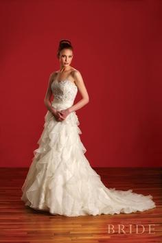 Lexington by Badgley Mischka, available at Alta Moda Bridal. Photographed by InStudio. #utahvalleybride #weddingdress #ruffle
