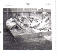 Playing in the backyard sandbox.
