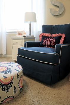 Love this nursery, navy & pink is a classic combo! The monogram pillow, tailored rocker, ottoman, galvanized letter, banner, door hanger, chalkboard...perfect!