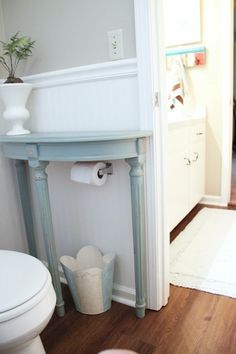 9. Add a half table over a toilet paper holder to save space in a small bathroom.