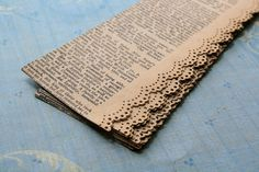 lace punched old book pages / seems like a great idea to add to something :)