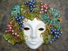 "This beautiful collectible Italian ceramic face mask depicts the season of autumn with lush grapes. Hand painted in Deruta.  Size: 10"" wide"