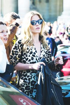 Animal print wrap dress and mirrored wayfarer sunglasses. // #StreetStyle
