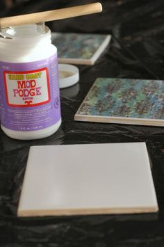 make your own coaster to match your decor with plain white tiles and scrap book paper, LOVE!