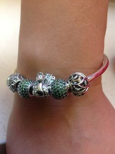 Pandora bangle with autumn charms in emerald tones