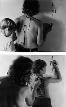 """Dennis Oppenheim - Two Stage Transfer Drawing 1971 """"As I run a marker along Eric's s back he attempts to duplicate the movement on the wall. My activity stimulates a kinetic response from his sensory system. I am, therefore, Drawing Through Him"""""""
