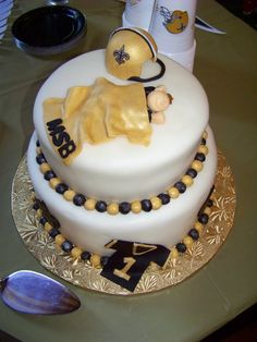Thanks to Samantha Keene for sending this picture of her baby shower cake! #NOLA #Cake #Saints #Babyshower