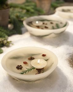 Complete any table setting with a stunning wax bowl centerpiece filled with floating candles, mini pinecones, and dried greenery.