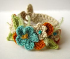 crochet flower bracelet...love the colors  (This is crazy - I HAVE to learn to crochet..)