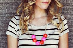 Give wooden beads a glossy coat of paint to DIY this cool necklace.