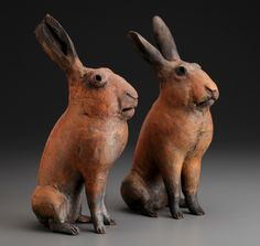Pair of Spring Rabbits.  Moulded and soft slabbed paperclay. Raku fired with colloidal slip (sold).