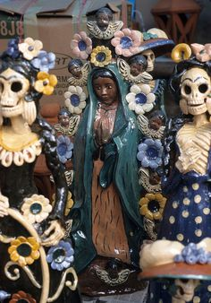 Ceramic artworks from Capula Michoacan on sale at the Day of the Dead market in Pátzcuaro  Skeletons and La Virgen de Guadalupe