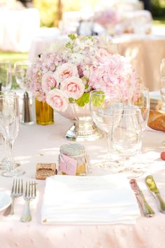 Beautiful blush colored roses, antique flatware and sterling silver accents set the stage for gorgeous entertaining!