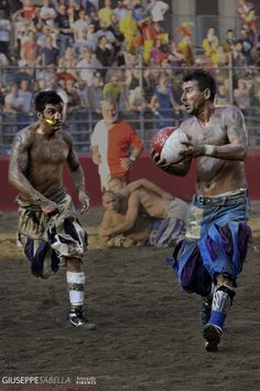 Calcio Storico Fiorentino: The square in front of 15th century Basilica of Santa Croce in the heart of Florence is transformed into a sand-covered playing field for Calcio Storico.