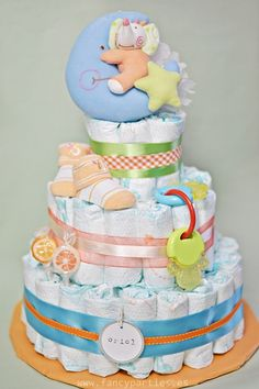 Orange, Blue and Green Modern Diaper Cake by www.fancyparties.es #diapercake #diaper #newborngift