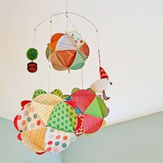 DIY-Make your own mobile out of paper globes!  Printable PDF template included!  Customize it for a child's room or a birthday gift.