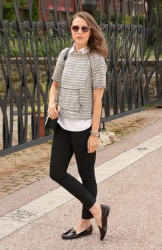 Blogger Penny Pincher Fashion wears her Gap black skinny jeans with chic loafers.