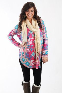 "Southwestern Tunic, Pink $37.50  You DO NOT want to miss this tunic! This super soft top has bold tribal patterns in bright beautiful colors, and we love the long length and dolman sleeves! Throw it on over leggings or skinny jeans for an outfit that's unbeatably comfy and cute, too!   Fits true to size. Miranda is wearing a small.   From shoulder to hem:  Small - 30""  Medium - 31""  Large - 32"""
