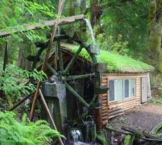 green roof - small wood house - and a water wheel!  // Water wheel producing 24 kw power/day on 20 cm of running water - 2 thousand pounds installed, paid for in 2 years