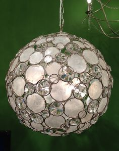 2012 Fall Market Trend: Hand inlaid chandelier with capiz shells and crystals by Crystorama http://www.crystorama.com/ Loloi Showroom IHFC D320 #hpmkt #stylespotters