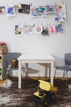 We love the idea of displayed children's artwork in their playroom. Let their imagination run wild! #playroom