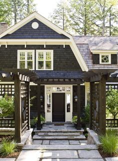 The owners brought in natural granite to emulate the native landscape, covered the exterior in dark-stained cedar shingles and stone, and opted for a gambrel roof that allows for a semi second storey without towering above the trees.