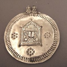 A beautiful silver protection amulet dating from the late 19th century and showing the footprints of Vishnu ...  a collector's item but also perfectly portable!