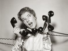 1950s woman overwhelmed on phone