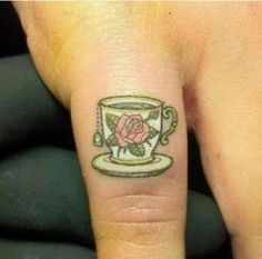 teacup tattoo on the pinky