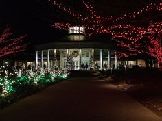 The Visitor Pavilion is lit up during Holiday Lights at Daniel Stowe Botanical Garden