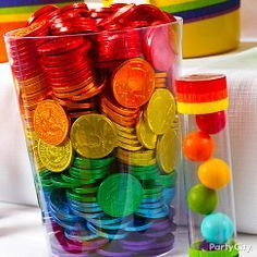 "Pot o' gold anyone? How about pot o' chocolate goodness?! Layer rainbow colored ""coins"" for party guests to grab during the festivities!"