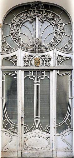 Amazing silvery art deco door and window decoration.  in Berlin - Jugendstil 006 by Arnim Schulz, via Flickr.