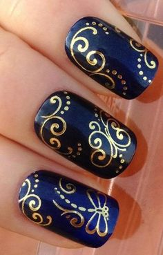 Intricate design - gold swirl on royal blue #Nails #NailDesign www.spice4life.co.za