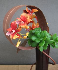 Orchids w/ succulents and leaf