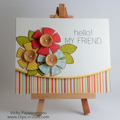 handmade greeting card ... luv the big friendly greeting ... trio of paper pieced flowers ... cute wood button centers with butterflies stained on the center .. like the die cut curved edge ... great card!!