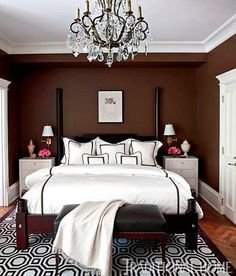 Chocolate brown walls are warm and inviting, while white bedding provides a crisp contrast - Traditional Home® / Photo: Werner Straube / Design: Tom Stringer