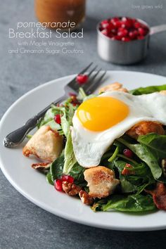 Pomegranate Breakfast Salad with Maple Vinaigrette and Cinnamon Sugar Croutons - What a fun breakfast idea! So many amazing flavors and textures in this unique dish! A MUST try! pomegran breakfast, cinnamon sugar, croutons, fun breakfast, sugar crouton, breakfast idea, breakfast salad, pomegranates, mapl vinaigrett