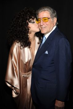 The art of romance. Lady Gaga showers Tony Bennett with kisses during a surprise appearance at the Frank Sinatra School of the Arts on June 16 in New York