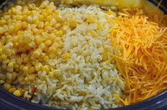 Slow Cooker Cheesy Chicken and Rice-Yellow Rice, Cream of Chicken, Whole kernel corn, onion, chicken breasts, and shredded cheddar cheese.
