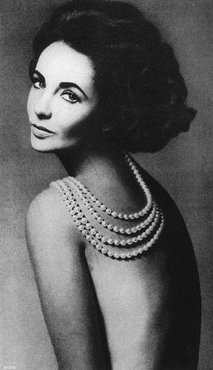 Elizabeth Taylor's bare back displays cultured pearls from Tiffany's, photo by Avedon, Harper's Bazaar, Sept. 1960