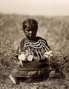 Running Owl's Daughter, a Piegan Indian Baby. 1910 by Edward S. Curtis.