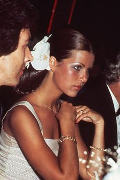 I've always loved a woman who wears flowers in hair... Princess Caroline of Monaco, 1970's.