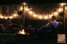 Enjoying the backyard by the light of string lights and a fire. The reward after completing an amazing backyard makeover. Click through to see more of Anna Lisemeyer's outdoor decorating ideas on The Home Depot Blog. || @Anna @ IHOD