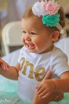 Aqua, gold, and pink girls first birthday outfit on Etsy, $49.95