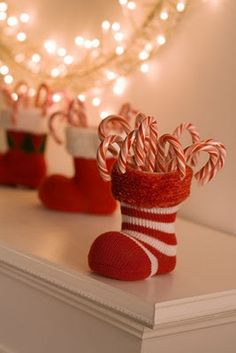 Baby Christmas socks w/empty toilet paper rolls to hold upright +fill with candy canes = Voila