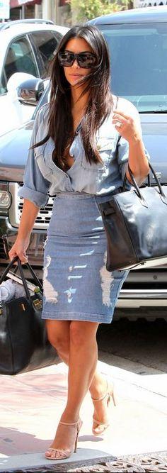 Kim Kardashian: Purse – Hermes  Shoes – Prada  skirt – Frame  Shirt – Current/Elliot
